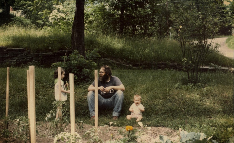 Baby Emily in the garden with her sister and dad circa 1978